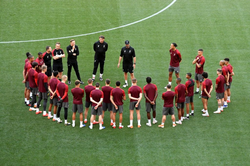 Klopp (centre) addressing his squad during a training session.