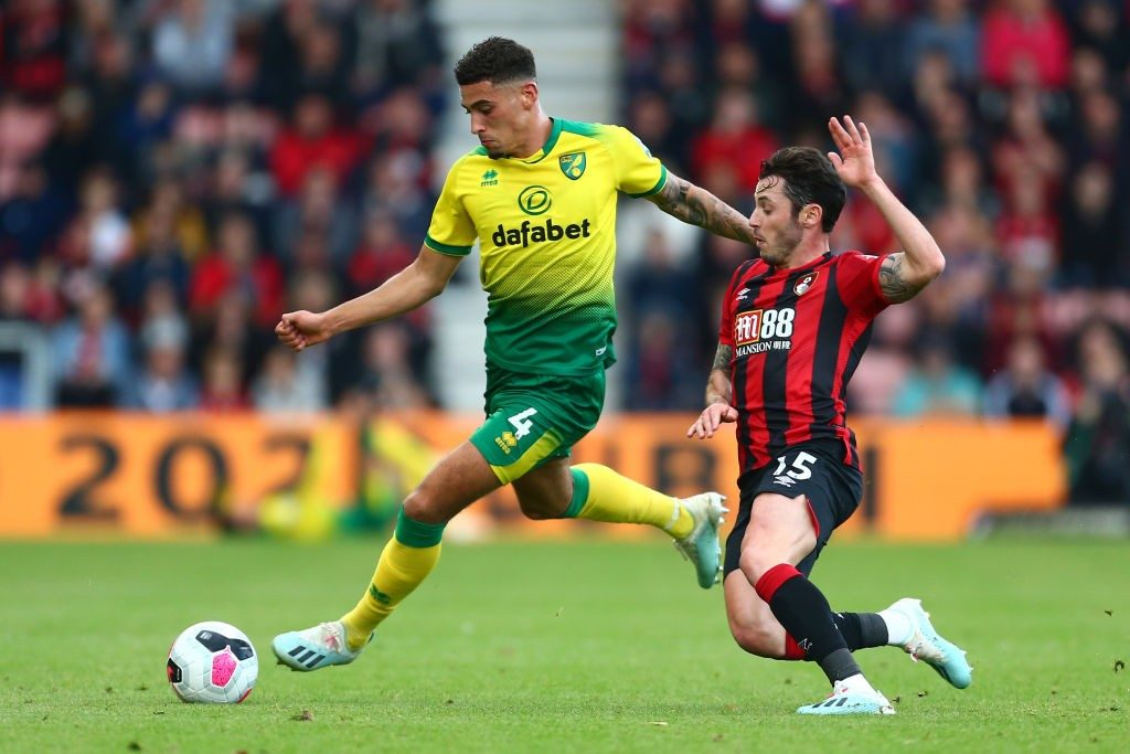 en Godfrey of Norwich City is challenged by Adam Smith of AFC Bournemouth during the Premier League match between AFC Bournemouth and Norwich City at Vitality Stadium.
