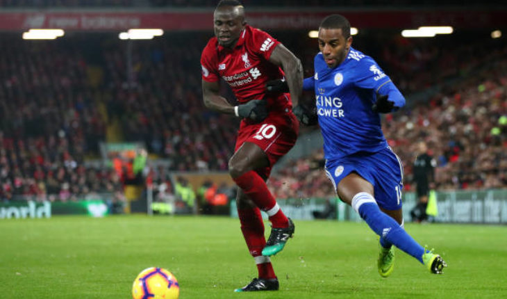 Ricardo Pereira of Leicester City battles with Sadio Mane of Liverpool during a Premier League match at Anfield.
