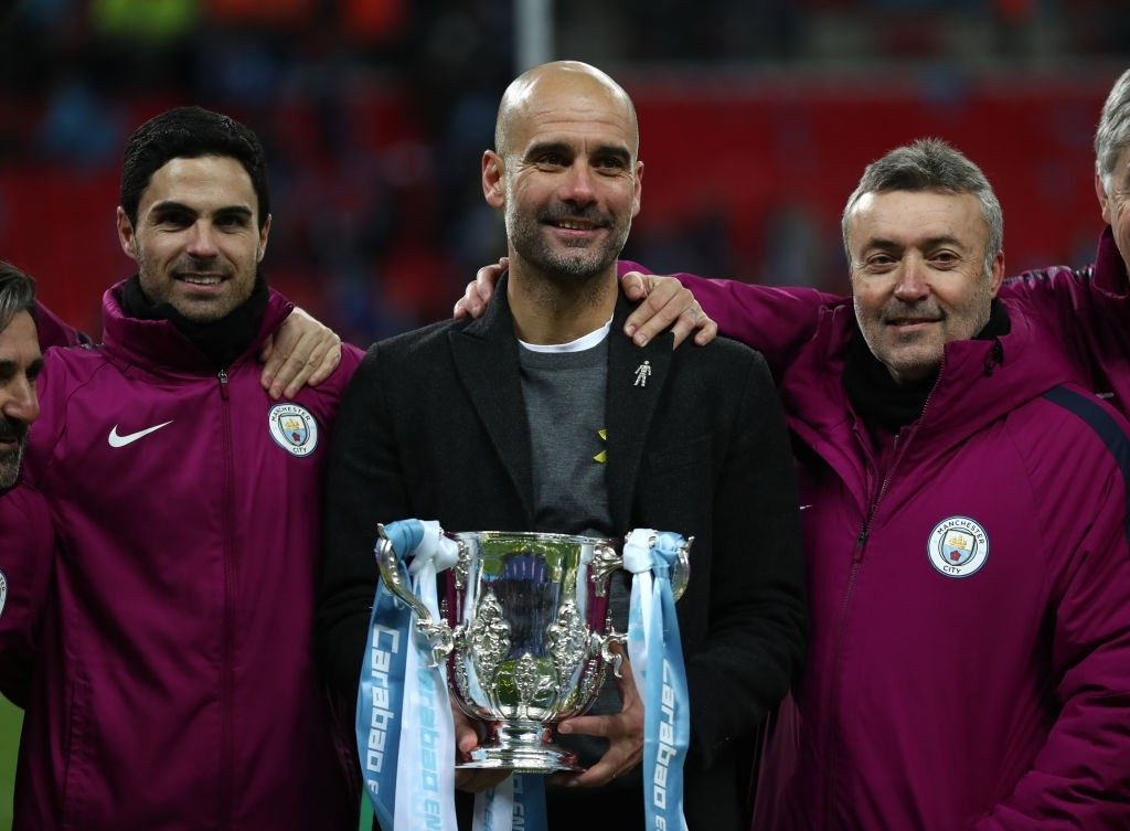 Mikel Arteta (left) alongside Manchester City boss Pep Guardiola.