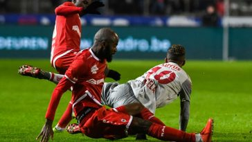Antwerp's Didier Lamkel Ze, Standard's Mehdi Carcela and Antwerp's Aurelio Buta fight for the ball during a soccer match between Royal Antwerp FC and Standard de Liege. (Getty Images)