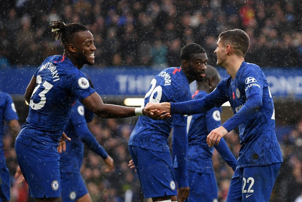 Chelsea players celebrating a goal during a premier league encounter.
