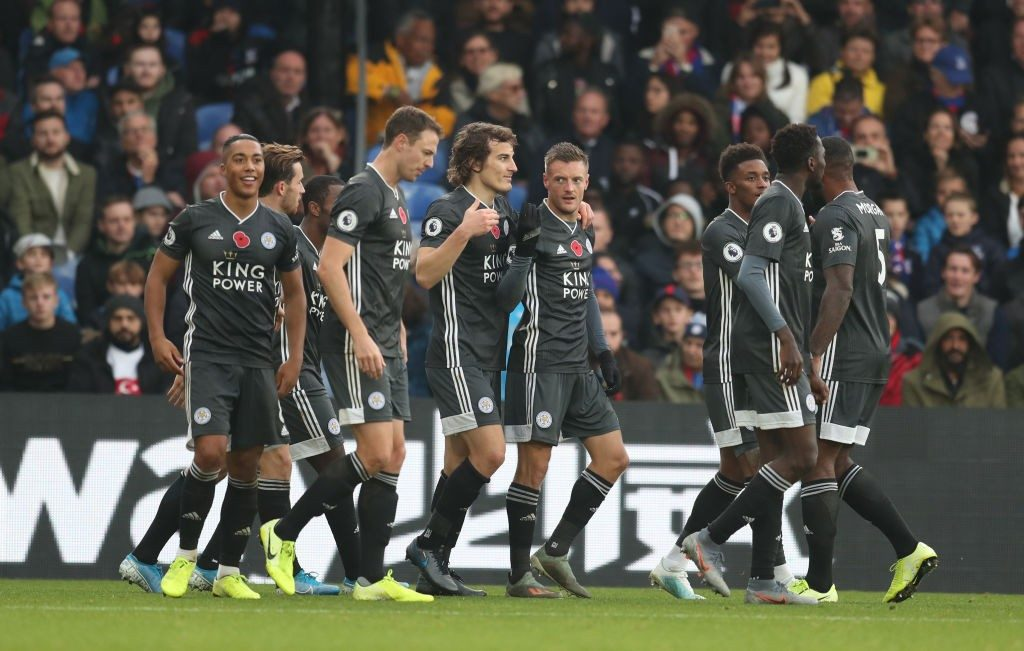 Leicester players celebrating a goal during a premier league match.
