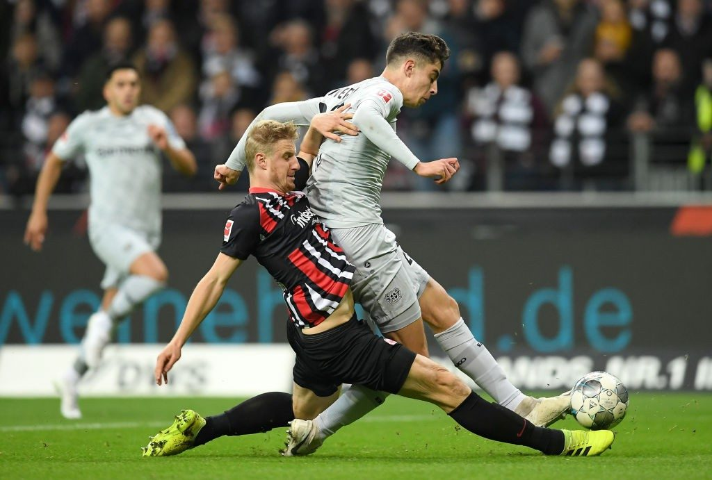 Eintracht Frankfurt defender Martin Hinteregger goes for a tackle against Bayern Leverkusen's Kai Havertz.