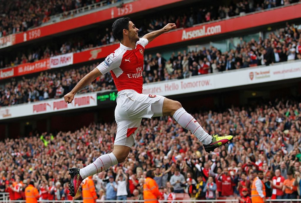 An ecstatic Arteta celebrates during his playing days with Arsenal.