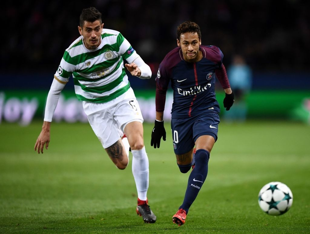 Celtic's Nir Bitton (left) in a tight tussle with PSG's Neymar.