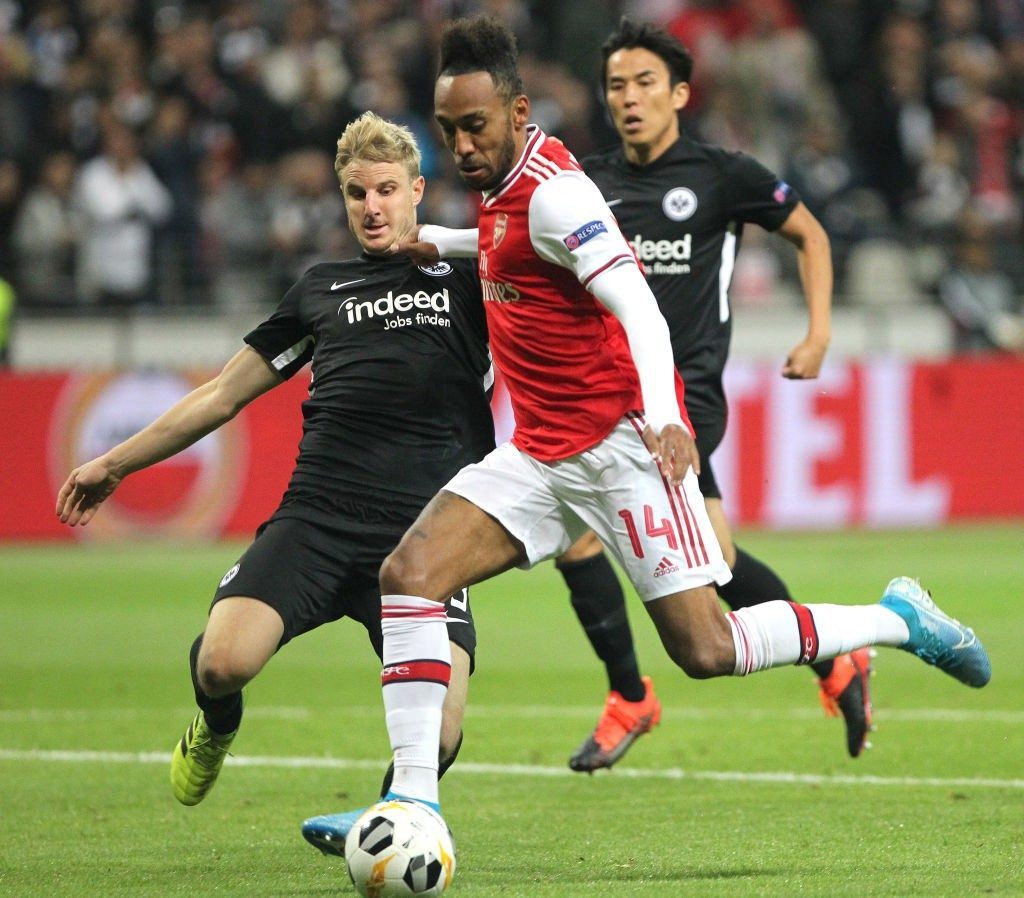 Frankfurt defender Hinteregger tries to stop Arsenal striker Pierre-Emerick Aubameyang.