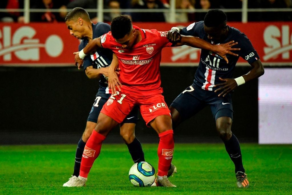 Dijon's Mounir Chouiar tries to go past two players in a league encounter