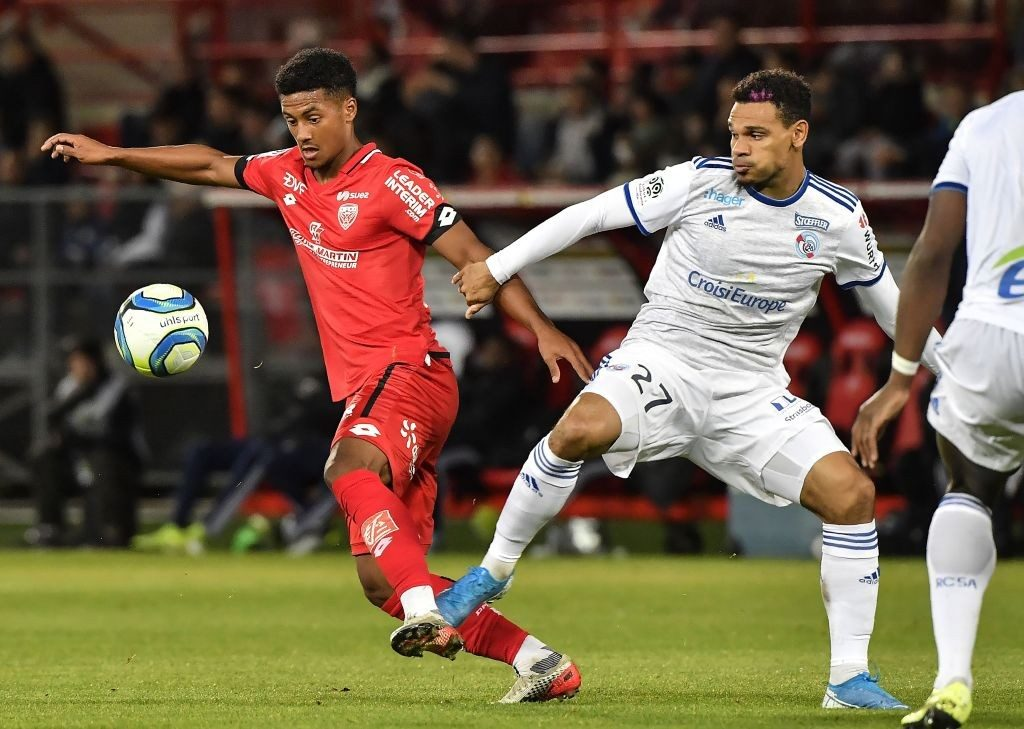 Dijon's Mounir Chouiar (left) in full swing during a French league match.