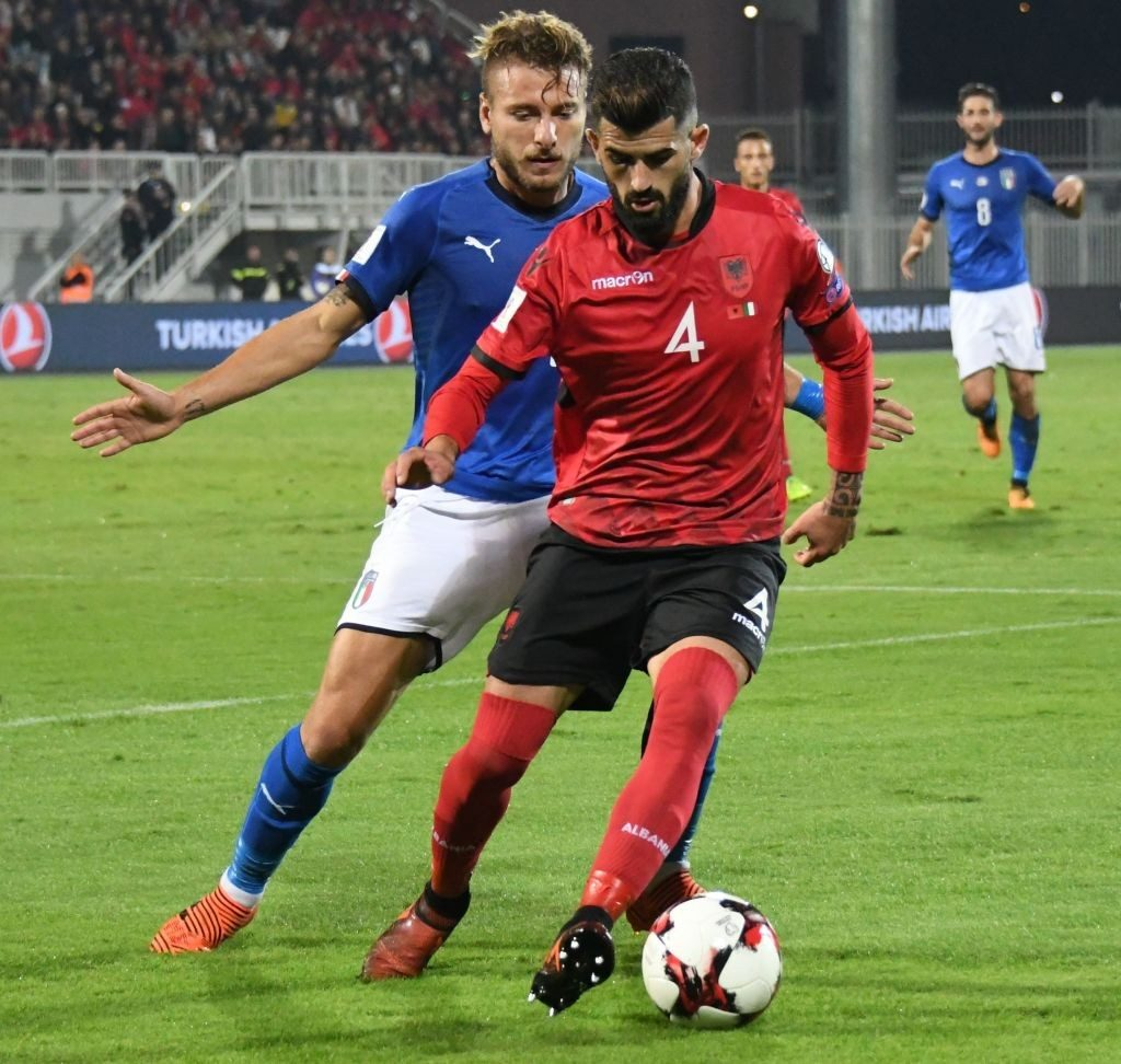 Hysaj playing for Albania against Italy.