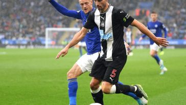 Fabian Schar of Newcastle United is challenged by Jamie Vardy of Leicester City during the Premier League match between Leicester City and Newcastle United. (Getty Images)