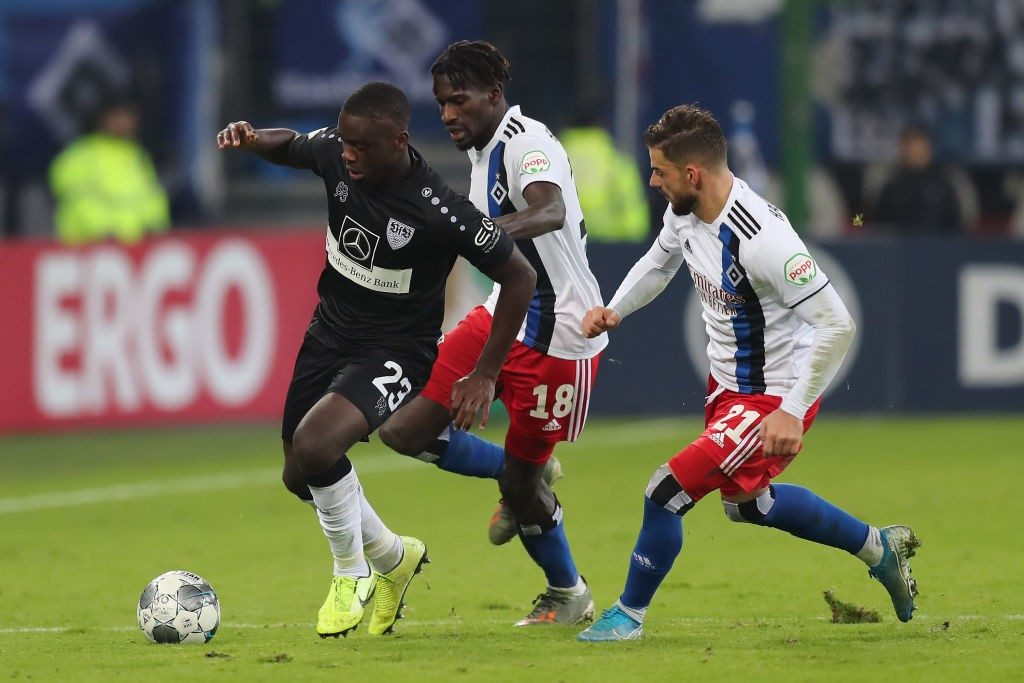 VfB Stuttgart's Orel Mangala (extreme left) engages in a tussle during their league encounter against Hamburg SV.