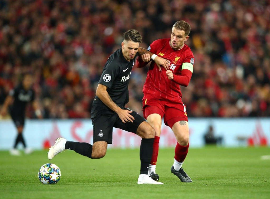 Szoboszlai (left) engages in a tussle with Liverpool midfielder Jordan Henderson.