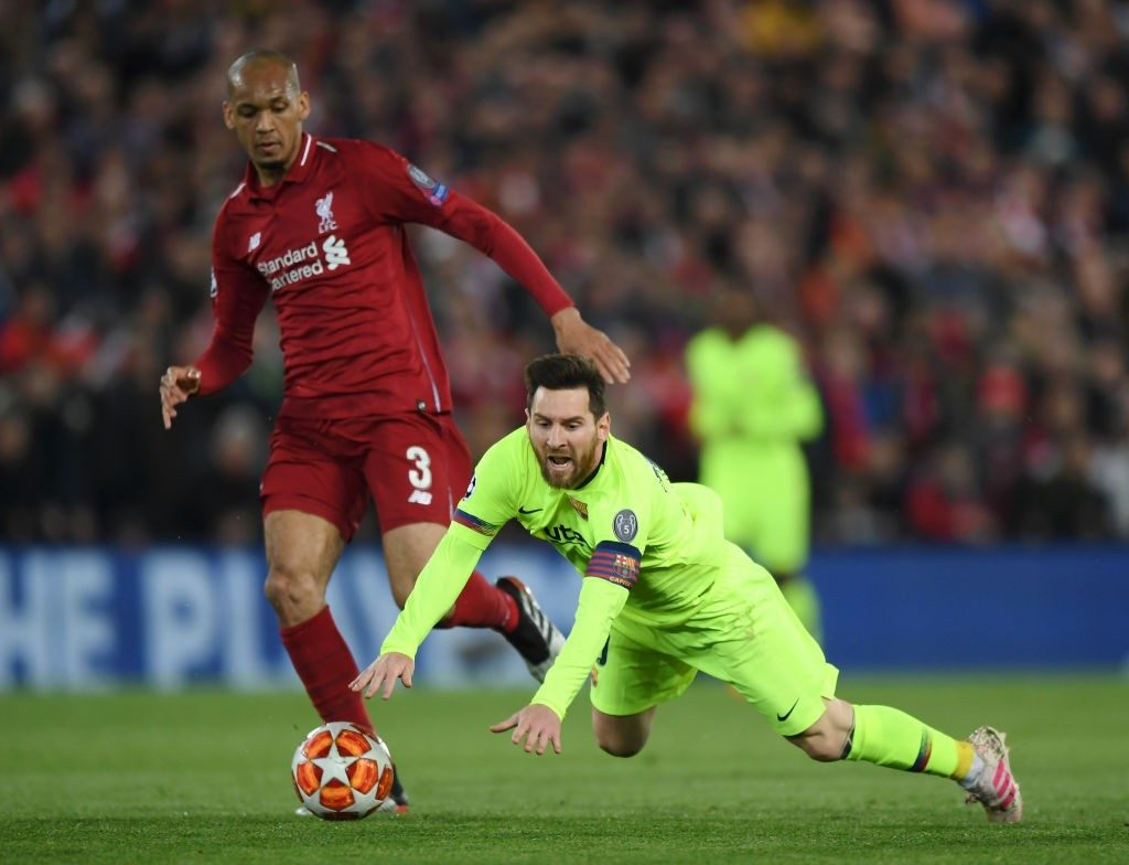Fabinho (left) taking on Lionel Messi during their Champions League encounter last season.