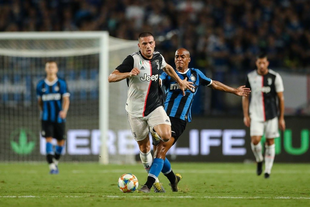 Merih Demiral of Juventus and Joao Mario of FC Internazionale in action during the International Champions Cup match at the Nanjing Olympic Center Stadium.
