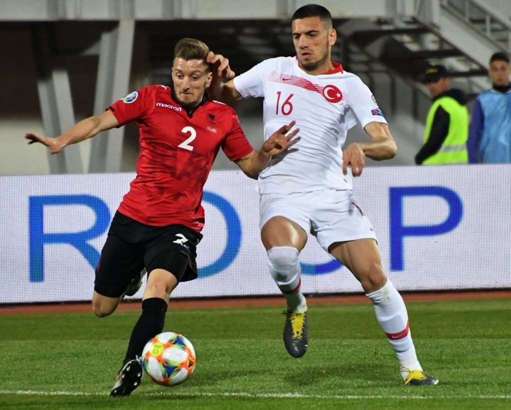 Albania's midfielder Ivan Balliu (left) vies for the ball with Turkey's Merih Demiral during the Euro 2020 Group H qualification football match at the Loro Borici Stadium in Shkodra.