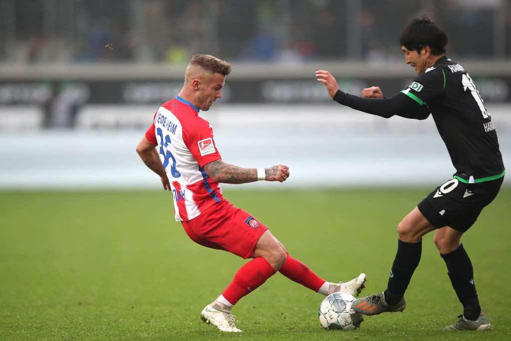 Niklas Dorsch of 1.FC Heidenheim challenges  Genki Haraguchi of Hannover 96 during the Second Bundesliga match between 1. FC Heidenheim 1846 and Hannover 96 at Voith-Arena. (Getty Images)