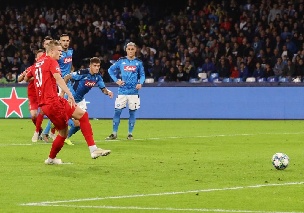 Haaland tries a shot in his side's group encounter against Napoli in the Champions League.