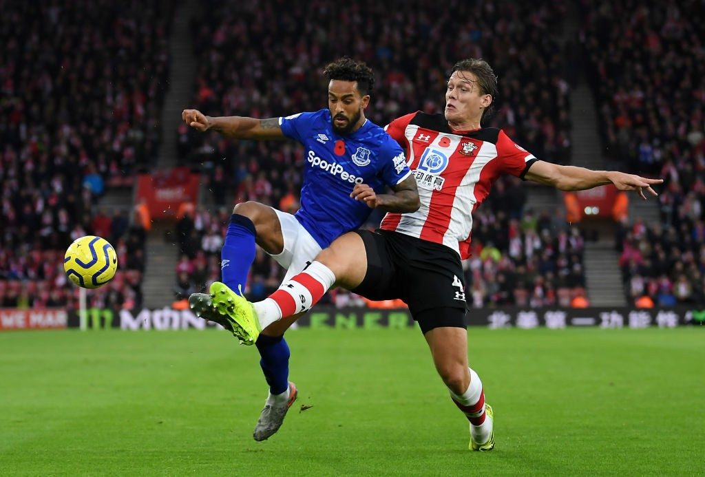 Southampton defender Jannik Vestergaard engages in a tussle with Everton winger Theo Walcott.