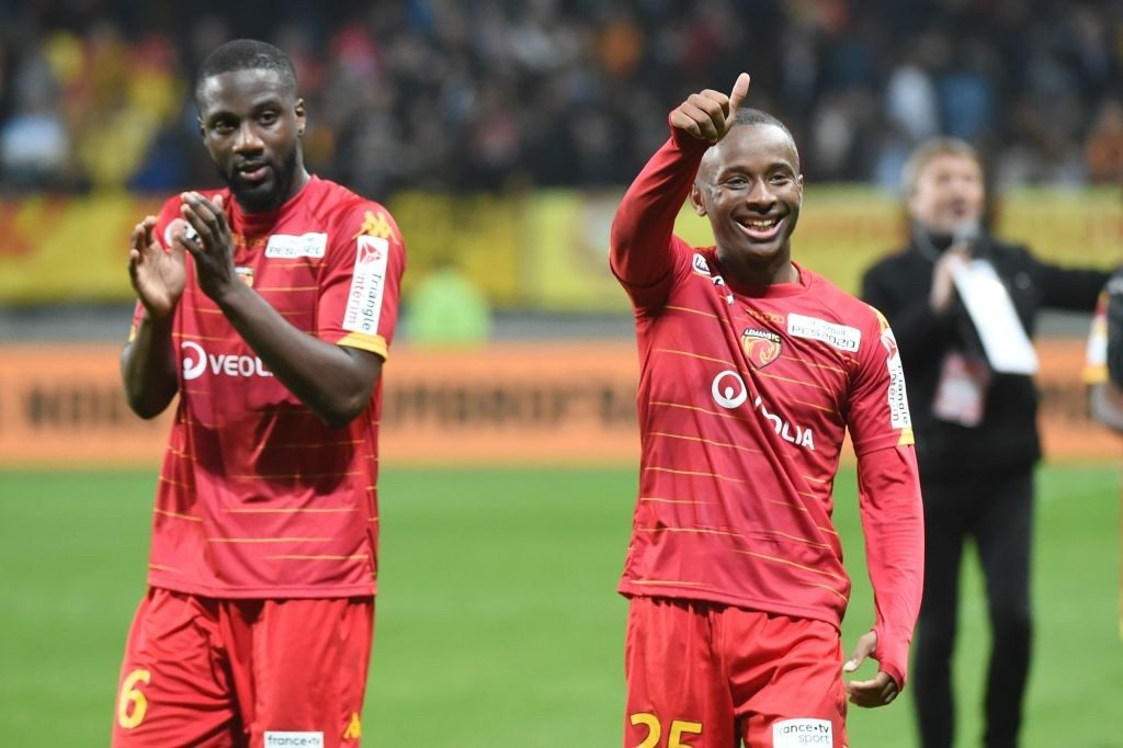 Le Mans' French midfielder Gussouma Fofana (L) and French forward Stephane Diarra (R) celebrate aftre winning the French Ligue Cup round of 32 football match between Le Mans FC and OGC Nice. (Getty Images)