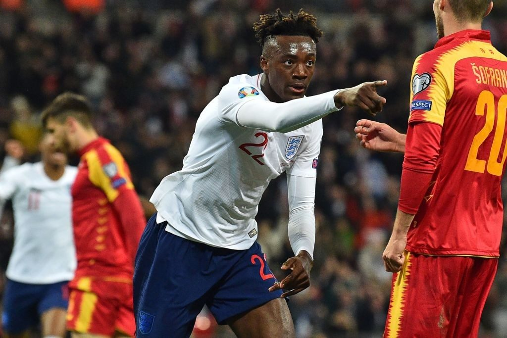 Tammy Abraham celebrates scoring a goal against Montenegro in the Euro qualifiers.