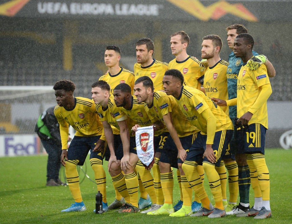 Arsenal players assemble for a team photo before the match.