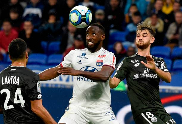 Lyon's French forward Moussa Dembele (C) challenges Dijon's French defender Wesley Lautoa (L) and midfielder Bryan Soumare during the French Ligue 1 football match.