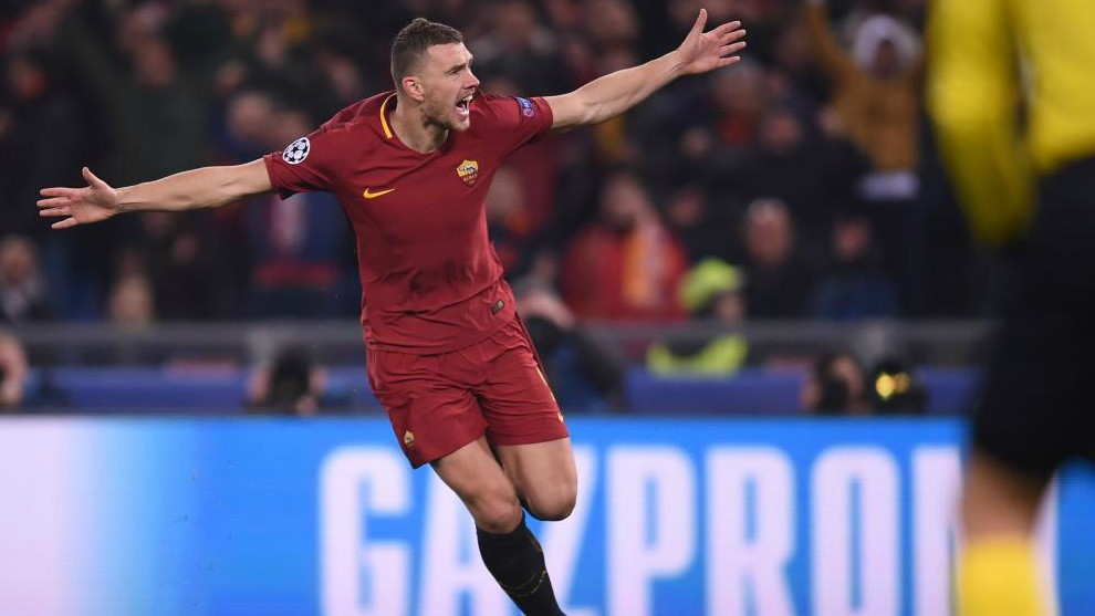 Roma striker Eden Dzeko celebrates after scoring a goal.