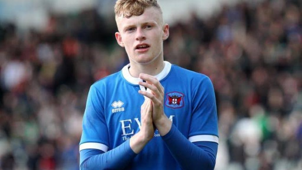 Young Branthwaite applauds the crowd after his side's game in League Two.