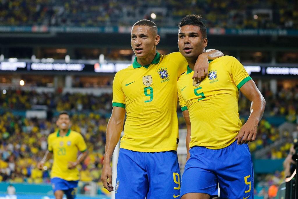 Richarlison alongside his Brazil teammate Casemiro during the Copa America.