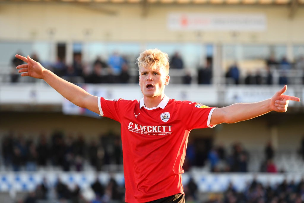 Cameron McGeehan of Barnsley celebrates his team's promotion at full-time after the Sky Bet League One match between Bristol Rovers and Barnsley at Memorial Stadium. (Getty Images)