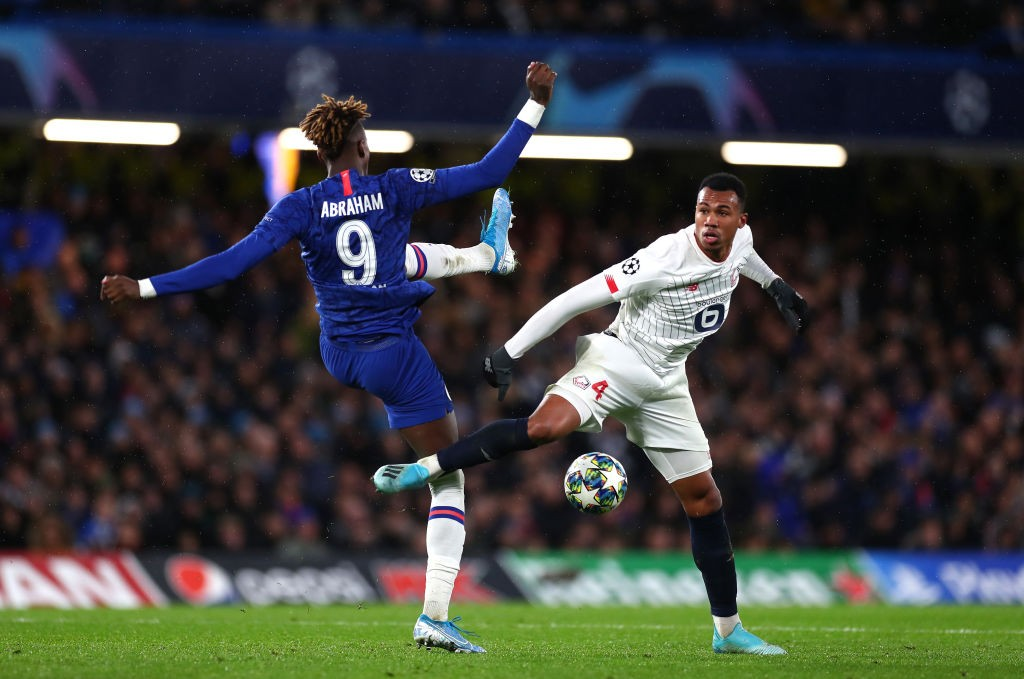 Lille defender Gabriel fights for the ball with Chelsea's Tammy Abraham in the Champions League match between the two sides.