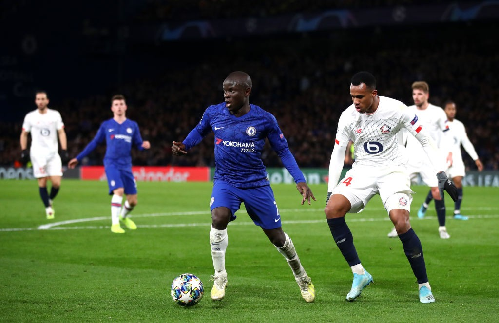 Chelsea's N'Golo Kante is being marked by Lille's Gabriel.