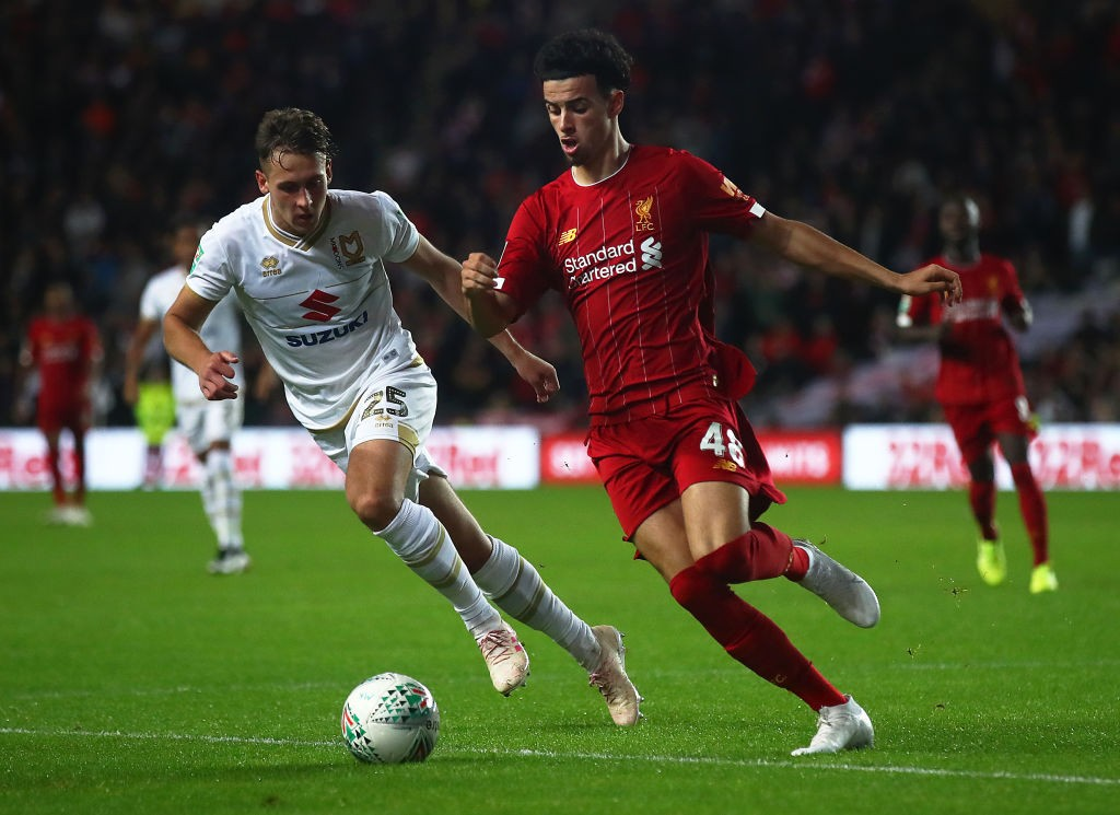 Curtis Jones of Liverpool in action with Callum Brittain of MK Dons during the Carabao Cup Third Round match between MK Dons and Liverpool at Stadium mk on September 25, 2019 in Milton Keynes, England. (Getty Images)