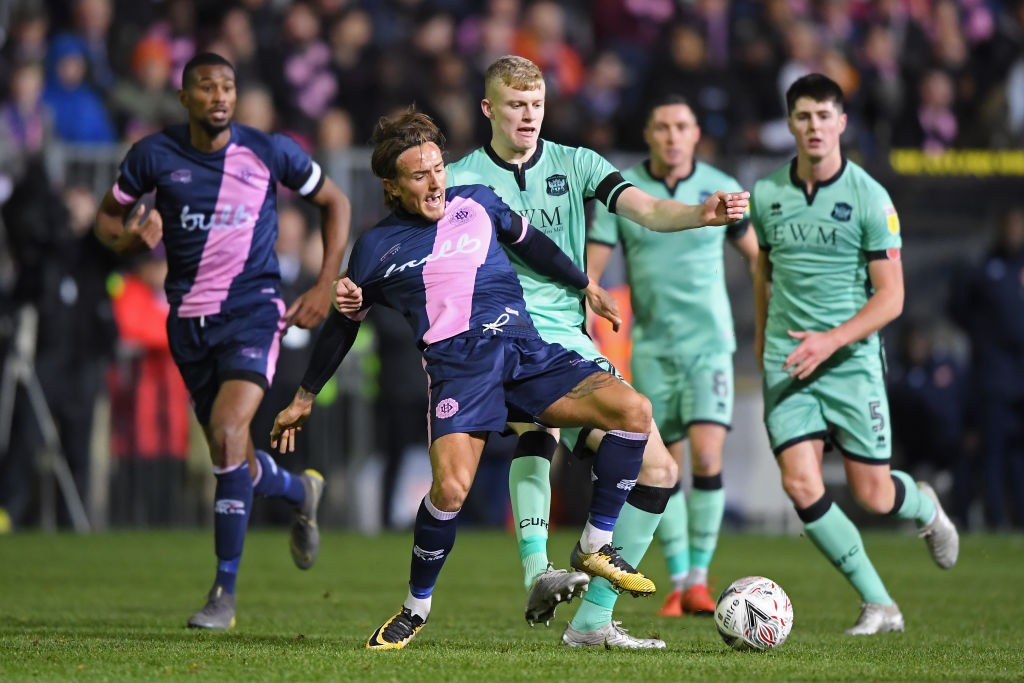 Carlisle United teenager Jarrad Branthwaite (right) tries to snatch the ball away from a Dulwich Hamlet player.