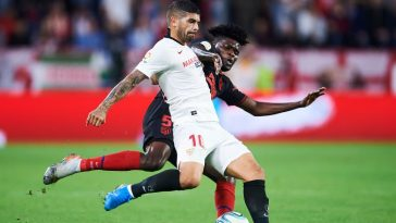 Ever Banega of Sevilla FC (R) duels for the ball with Thomas Teye Partey of Club Atletico de Madrid (L) during the Liga match between Sevilla FC and Club Atletico de Madrid at Estadio Ramon Sanchez Pizjuan. (Getty Images)