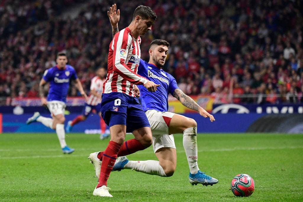 Nunez goes for a tackle against Atletico Madrid's Alvaro Morata.