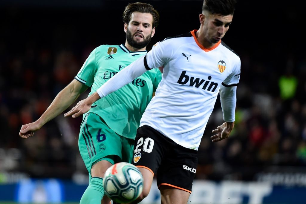 Torres in action for Valencia against Real Madrid.