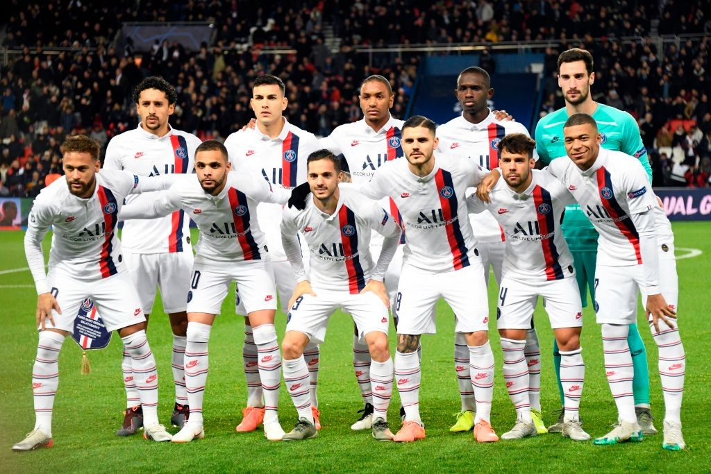 PSG players pose for a photo ahead of a Champions League game.