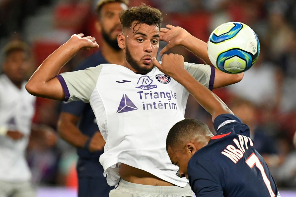 Toulouse defender Mathieu Goncalves fights for the ball against PSG's Kylian Mbappe.
