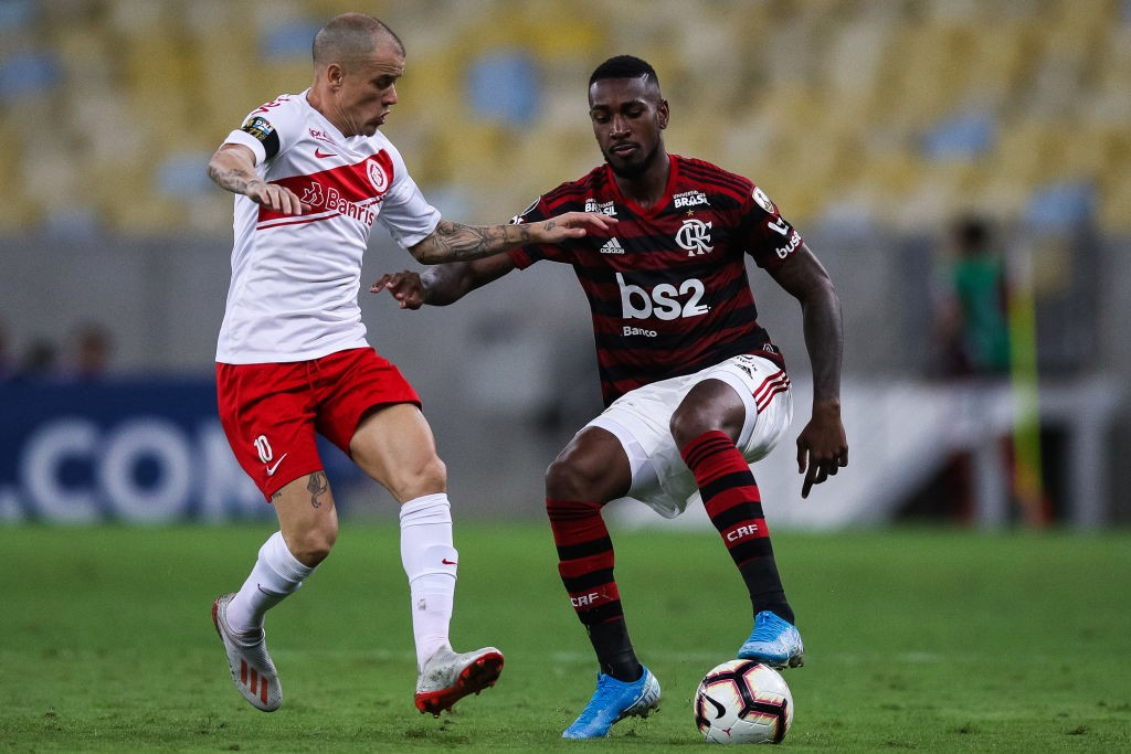 Gerson of Flamengo battles for the ball during a game.