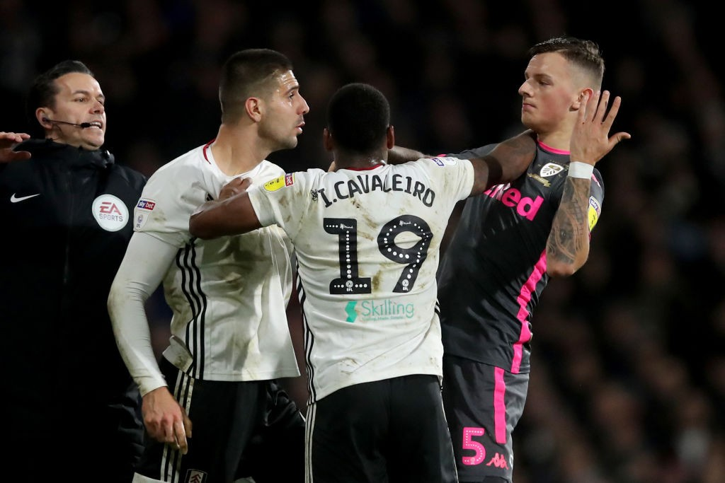 Tempers flare between Aleksandar Mitrovic, Ivan Cavaleiro of Fulham and Ben White of Leeds United during the Sky Bet Championship match between Fulham and Leeds United at Craven Cottage on December 21, 2019 in London, England. (Getty Images)