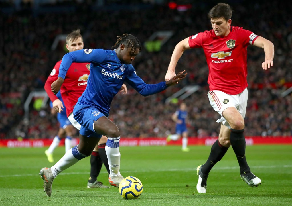 Moise Kean of Everton is put under pressure by Harry Maguire of Manchester United at Old Trafford.