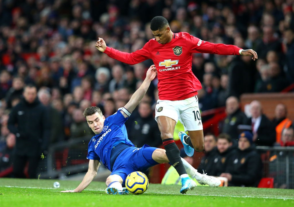 Seamus Coleman of Everton tackles Marcus Rashford of Manchester United during the Premier League match between Manchester United and Everton FC at Old Trafford on December 15, 2019 in Manchester, United Kingdom. (Getty Images)