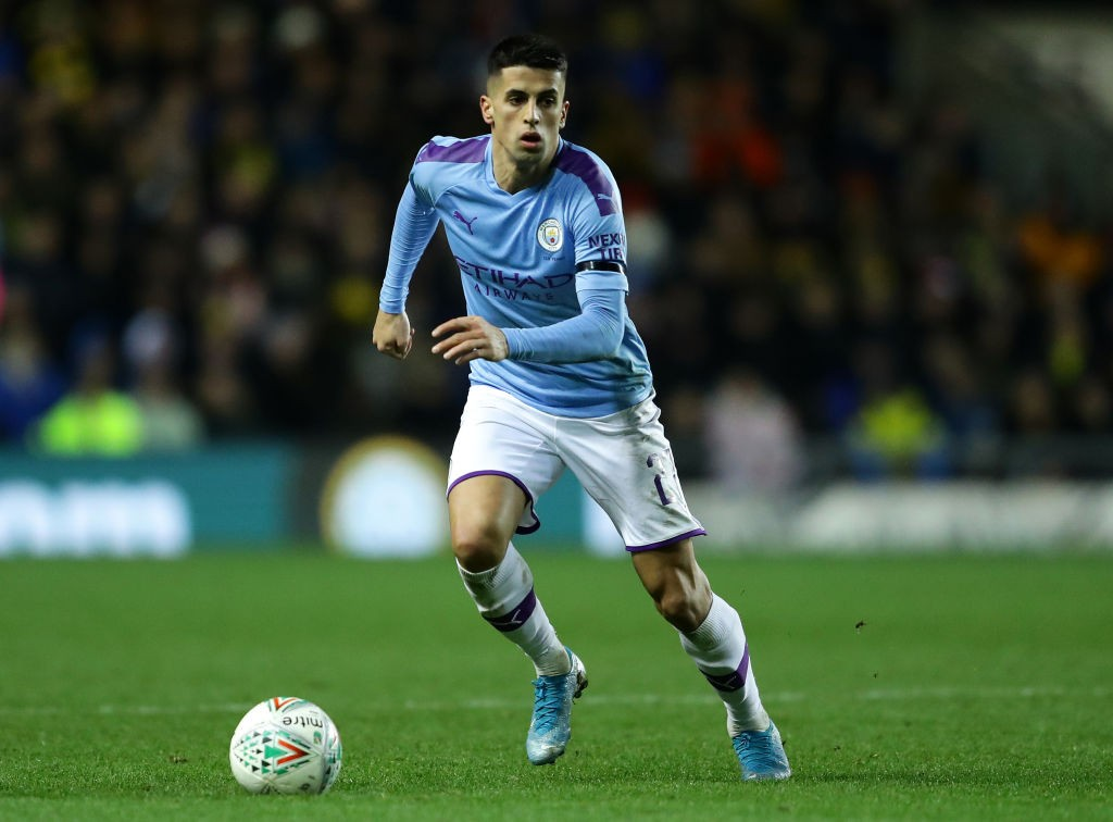 Cancelo playing for Manchester City.