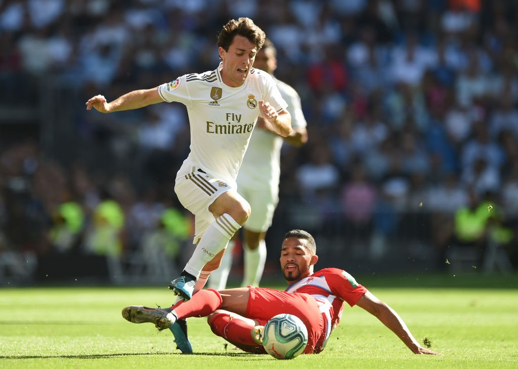 Madrid right-back Alvaro Odriozola runs past a Granada player during a La Liga encounter.