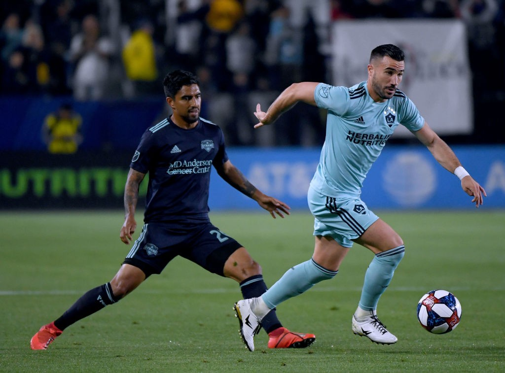 Romain Alessandrini of Los Angeles Galaxy controls the ball in front of A. J. DeLaGarza #20 of Houston Dynamo during a 2-1 Galaxy win at Dignity Health Sports Park. (Getty Images)