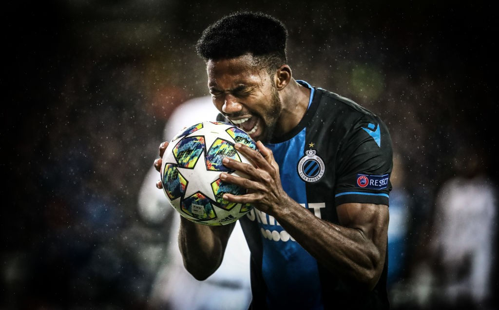 Emmanuel Dennis of Club Brugge celebrates after scoring a goal.