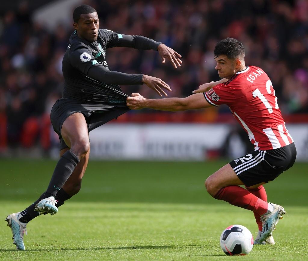 Egan in action against Liverpool during a Premier League encounter.