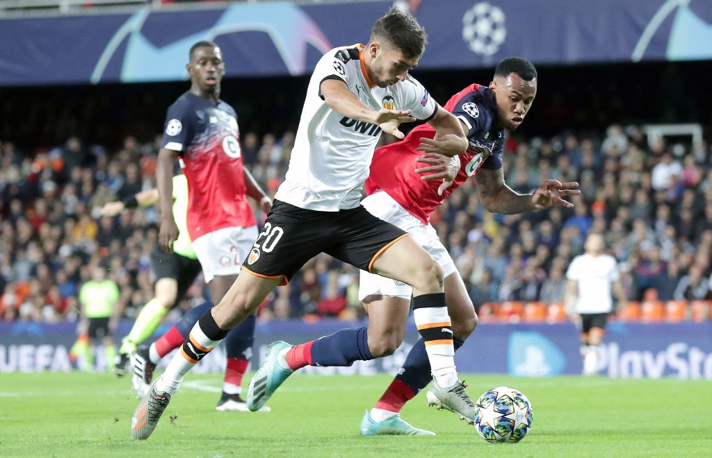 Gabriel engages in a tussle with a Valencia player during the Champions League.